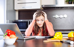 Stressed young woman is doing banking and administrative work ho Stock Photography