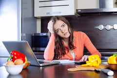 Stressed young woman is doing banking and administrative work ho Royalty Free Stock Photo