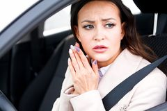 Stressed young woman driver in a car Stock Photo