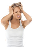 Stressed young woman with headache Royalty Free Stock Photos
