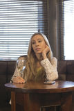 Stressed young woman at the pub Royalty Free Stock Photography