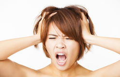 stressed young woman pulling  hair out Stock Images