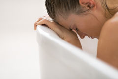 Stressed young woman sitting in bathtub Royalty Free Stock Photos