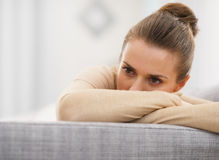 Stressed young woman sitting on sofa Stock Photography