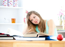 Stressed young woman studying in her kitchen Stock Image