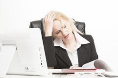 Stressed young woman at work royalty free stock photography
