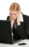 Stressful business woman working on laptop Royalty Free Stock Photography