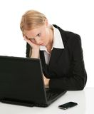 Stressful business woman working on laptop Royalty Free Stock Photo