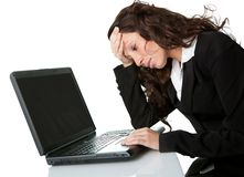 Stressful business woman working on laptop Royalty Free Stock Image