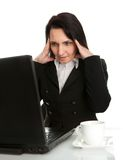 Stressful business woman working on laptop Stock Images