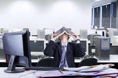 Stressful businessman covering his face Royalty Free Stock Photos