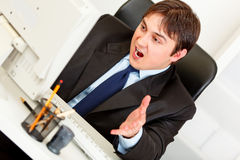 Stressful businessman looking at computer monitor Stock Images