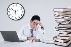 Stressful businessman at office. Depressed young businessman holding his head at office Royalty Free Stock Photos