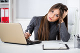 Stressful Businesswoman in the office Royalty Free Stock Images