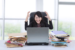 Stressful businesswoman screaming in office 1 Royalty Free Stock Photo