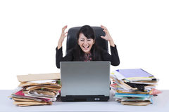 Stressful businesswoman screaming in office 2 Royalty Free Stock Photography