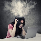 Stressful businesswoman with smoke on her head Stock Image