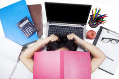 Stressful female learner lying on the floor Stock Images
