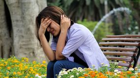 Stressful Female Sitting On Bench Royalty Free Stock Photo