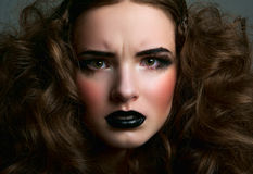 Stressful girl with black lips Royalty Free Stock Image