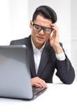 Stressful job, headache, migraine Stock Photos