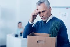 Stressed retire man leaving his office Stock Photography