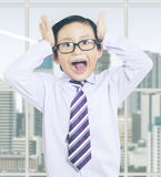 Stressful little businessman in office Stock Photos