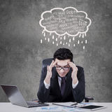 Stressful manager with cloud tag of problems Stock Photo