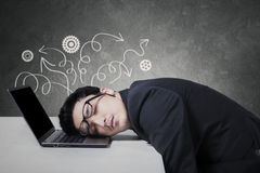 Stressful manager sleeping on laptop Stock Images