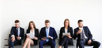 Stressful people waiting for job interview. Stressful people waiting for the job interview Royalty Free Stock Photo