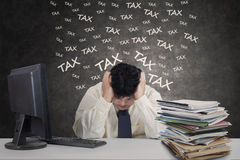 Stressful person with tax documents Royalty Free Stock Photo