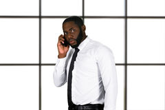 Stressful phonetalk in business center. Royalty Free Stock Photography