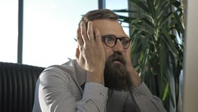 Stressful situation. Bearded business man in a office frustrated by a stalemate stock video