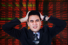 Stressful stock broker with hands on head Royalty Free Stock Photography