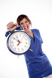 Stressful Time. Young Expressive Woman In Blue Uniform Shirt Holding A Big Alarm Clock Royalty Free Stock Photography