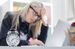 Stressful woman can't finish job on time Stock Photography