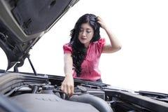 Stressful woman checking broken car machine Stock Photo