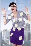 Stressful woman with empty notes Royalty Free Stock Images