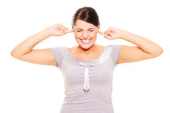 Stressful woman with fingers in ears Royalty Free Stock Image