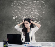 Stressful woman pay tax online Royalty Free Stock Photos