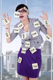 Stressful woman with tax reminders Royalty Free Stock Photos