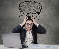 Stressful worker with cloud tag of problems Stock Photography