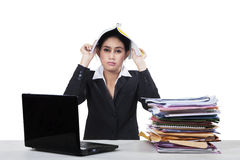 Stressful worker with document and laptop Stock Photos