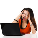 Stressful young asian woman working on laptop royalty free stock photography