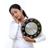 Stressful young business woman holding clock Royalty Free Stock Images