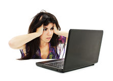 Stressful young woman working on laptop Stock Photography