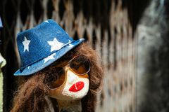 Street doll with hat and sunglasses. Stret doll with the hat, red lipstick and yellow sunglasses Stock Photography