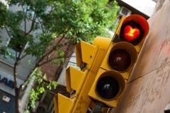 Stretart on signal light. Heart stretart on red signal light in street of Barcelona Stock Images