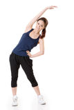 Stretch. Sport girl of Asian doing stretch exercise, full length portrait  on white background Royalty Free Stock Photo