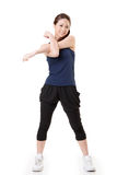 Stretch. Sport girl of Asian doing stretch exercise, full length portrait  on white background Stock Image